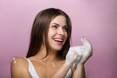 Beautiful young woman washing up her face Royalty Free Stock Photography