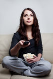 Beautiful young woman watching television Royalty Free Stock Photo