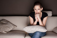 A beautiful young woman watching TV Royalty Free Stock Image
