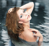 Beautiful young woman in water pool Stock Photography