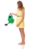 Beautiful young woman with watering can Royalty Free Stock Photos