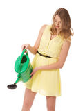 Beautiful young woman with watering can Stock Photography