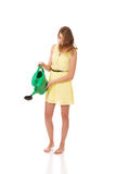 Beautiful young woman with watering can Royalty Free Stock Image
