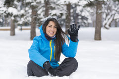 Beautiful young woman waving  in  the winter mountain Stock Image