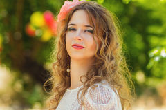 Beautiful young woman. With wavy hair in a smart suit Royalty Free Stock Photos