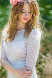 Beautiful young woman. With wavy hair in a smart suit Royalty Free Stock Photography