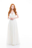 Beautiful young woman with wavy long hair in wedding dress Stock Photo