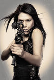 Beautiful young woman weapon Stock Photography