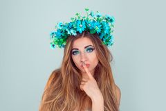 Puzzled young woman wearing floral headband stock photos