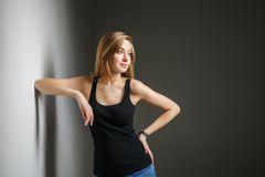 Beautiful young woman wearing black t-shirt Stock Photography