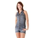 Beautiful young woman wearing blue jump suit stock photos