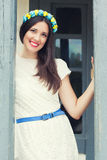 Beautiful young woman wearing blue and yellow wreath and posing Royalty Free Stock Photos