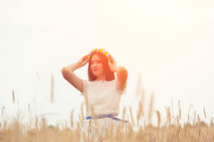 Beautiful young woman wearing blue and yellow wreath and posing Royalty Free Stock Image