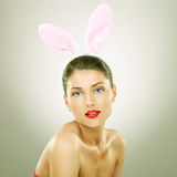 Beautiful young woman wearing bunny ears Stock Photo