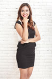 Beautiful young woman wearing casual dress Stock Images