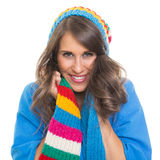Beautiful young woman wearing colorful winter hat and scarf smiling Stock Photo