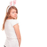 Beautiful young woman wearing cute bunny ears looking camera Royalty Free Stock Images