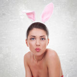 Woman wearing cute bunny  sending a kiss Stock Images