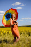 Beautiful young woman wearing dress with rainbow Royalty Free Stock Photos