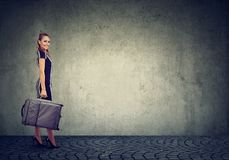 Beautiful young happy woman with suitcase ready to travel. Beautiful young woman wearing elegant dress with suitcase ready to travel Stock Images