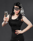 Beautiful young woman wearing a face masque Royalty Free Stock Photos