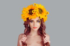 Beautiful young woman wearing floral headband royalty free stock photos