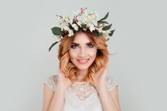 Beautiful young woman wearing floral headband toothy smile stock images