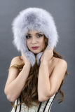 Beautiful Young Woman wearing Fur Hat. Royalty Free Stock Images