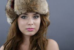 Beautiful Young Woman wearing Fur Hat. Stock Photos