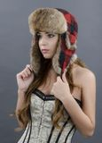Beautiful Young Woman wearing Fur Hat Stock Photo