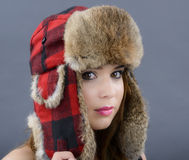 Beautiful Young Woman wearing Fur Hat Royalty Free Stock Image