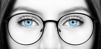 Beautiful young woman wearing glasses. Close-up shot royalty free stock photo