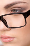 Beautiful young woman wearing glasses close-up. Royalty Free Stock Images