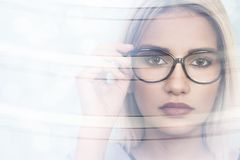 Beautiful young woman wearing glasses. Close-up shot royalty free stock image