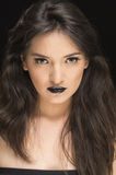Beautiful young woman wearing goth makeup Stock Images