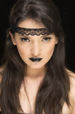 Beautiful young woman wearing goth makeup Royalty Free Stock Photography