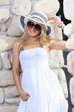 Beautiful young woman wearing a hat Stock Images
