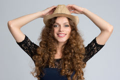 Beautiful young woman wearing hat and smiling at camera Stock Photography