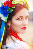 Beautiful young woman wearing national ukrainian clothes posing Stock Photo