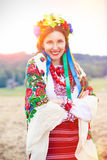 Beautiful young woman wearing national ukrainian clothes posing Stock Photos