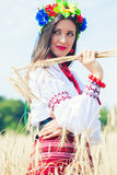 Beautiful young woman wearing national ukrainian clothes posing. In wheat field stock photos
