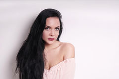Beautiful young woman wearing off-the-shoulder blouse Royalty Free Stock Photos