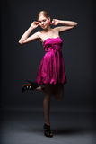 Beautiful young woman wearing pink dress. And black high heels shoes Royalty Free Stock Image