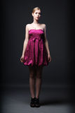Beautiful young woman wearing pink dress. And black high heels shoes Royalty Free Stock Photography