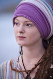 Beautiful young woman wearing purple headgear Royalty Free Stock Photography