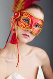 Beautiful Young Woman Wearing Red Carnival Mask Royalty Free Stock Photos