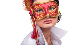 Beautiful young woman wearing red carnival mask Stock Photos
