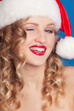 Beautiful young woman wearing Santa Claus costume Royalty Free Stock Images
