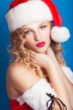 Beautiful young woman wearing Santa Claus costume Royalty Free Stock Photos