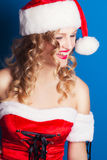 Beautiful young woman wearing Santa Claus costume Royalty Free Stock Photos
